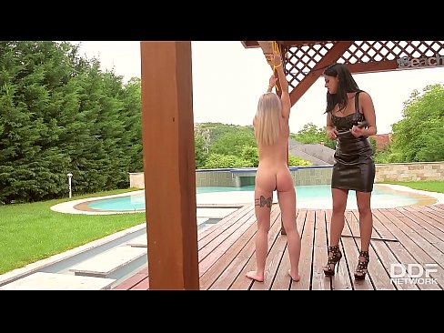 Latex domina Coco De Mal makes tied up Helena Valentine suck her clit in the outdoors