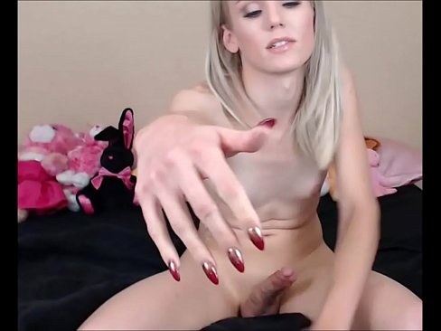 Young blonde shemale jerks her hard cock off