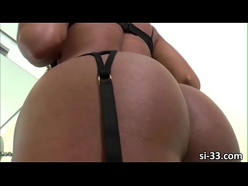 Tanned shemale Karol Kovalick blows a bigcock from behind