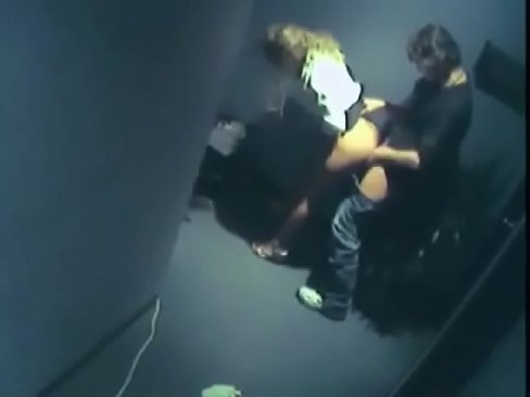 Hidden cam captures hallway sex