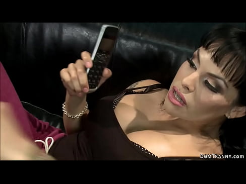 Brunette shemale TS Foxxy turns on beardy man Jesse Carl and ties him on the leather couch then spanks him and with hard dick anal fucks - XNXX.COM