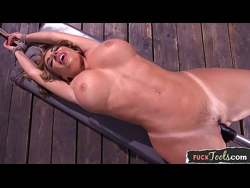 Busty milf fucked by machine while tiedup
