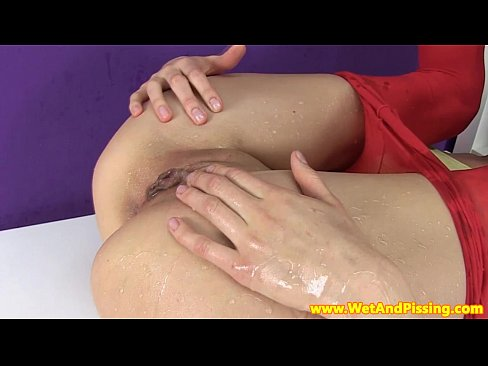Pissing action with a blackhaired babe