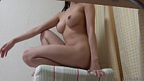 Petite girl shows off her boobs and waist line in the nude