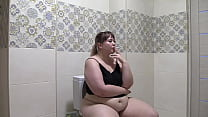 Mature bbw pisses while sitting on the toilet and smokes a cigarette Homemade fetish and juicy PAWG in panties