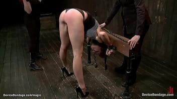 Bent and shackled lesbian ass flogged
