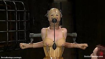 Slave in yellow latex vibrated