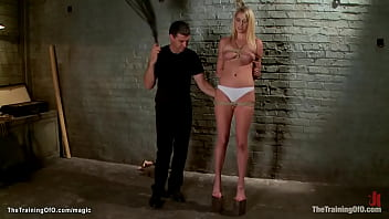 Bound trainee in wooden wall toyed