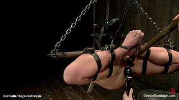 Shackled Blonde Oiled And Clamped